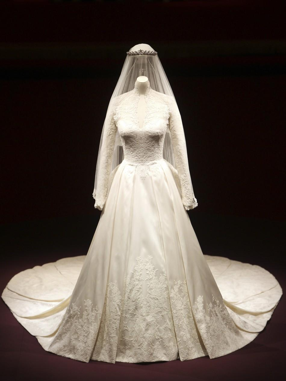 The wedding dress of Britain's Catherine, Duchess of Cambridge is seen as it is prepared for display at Buckingham Palace in London