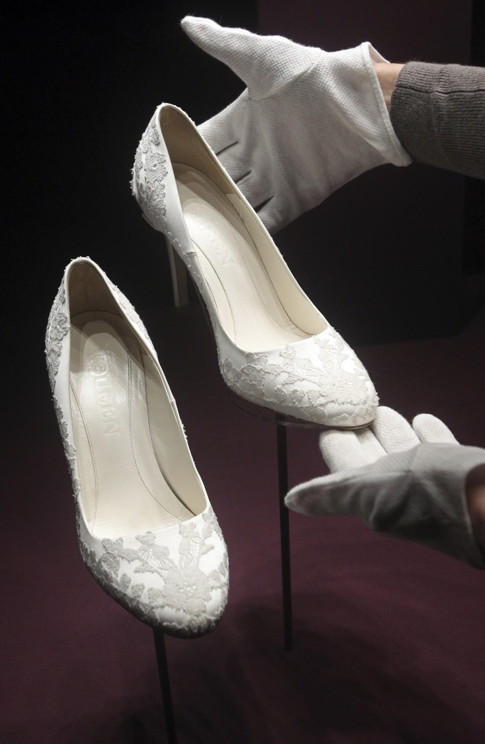 The bridal shoes of Britain's Catherine, Duchess of Cambridge are seen at Buckingham Palace in London