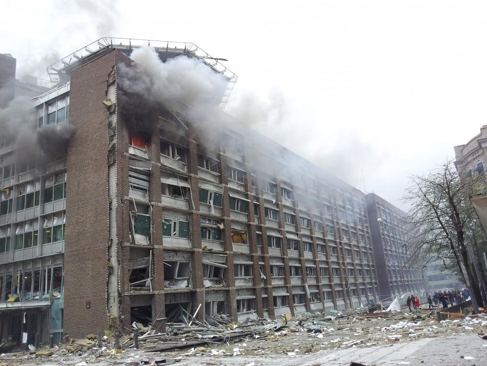 Smoke billows from a 17-storey government building after a powerful explosion rocked central Oslo