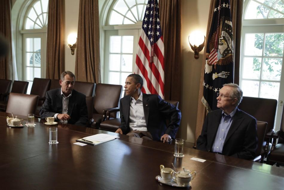 U.S. President Barack Obama (C) sit with House Speaker John Boehner (R-OH) (L) and Senate Majority Leader Harry Reid