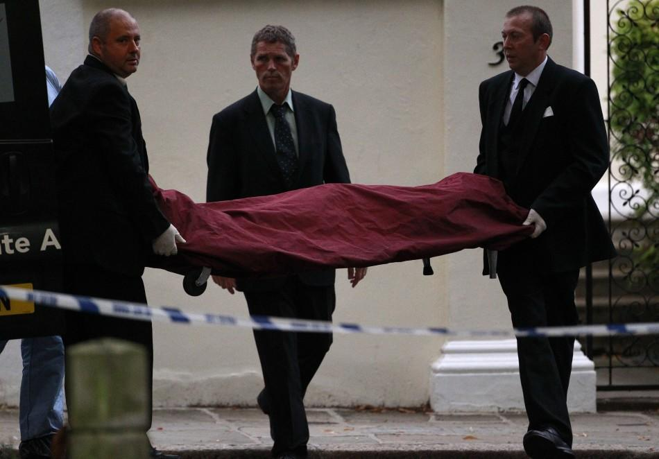 Amy Winehouse Dies at 27, Funeral workers carry the body of Amy Winehouse outside her house in London