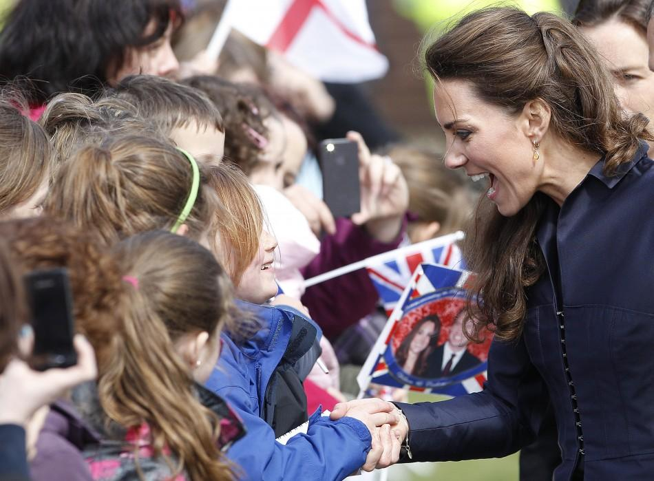 Kate Middleton talks to children