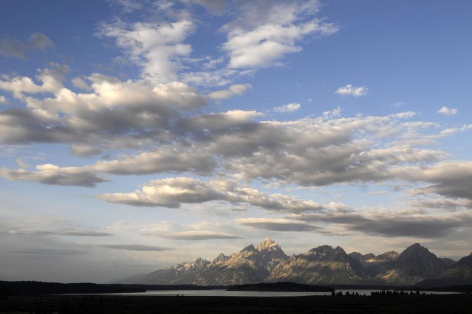 Morning sun hits the Grand Tetons as bankers and economists gather at the Jackson Hole Economic Symposium in Grand Teton National Park.