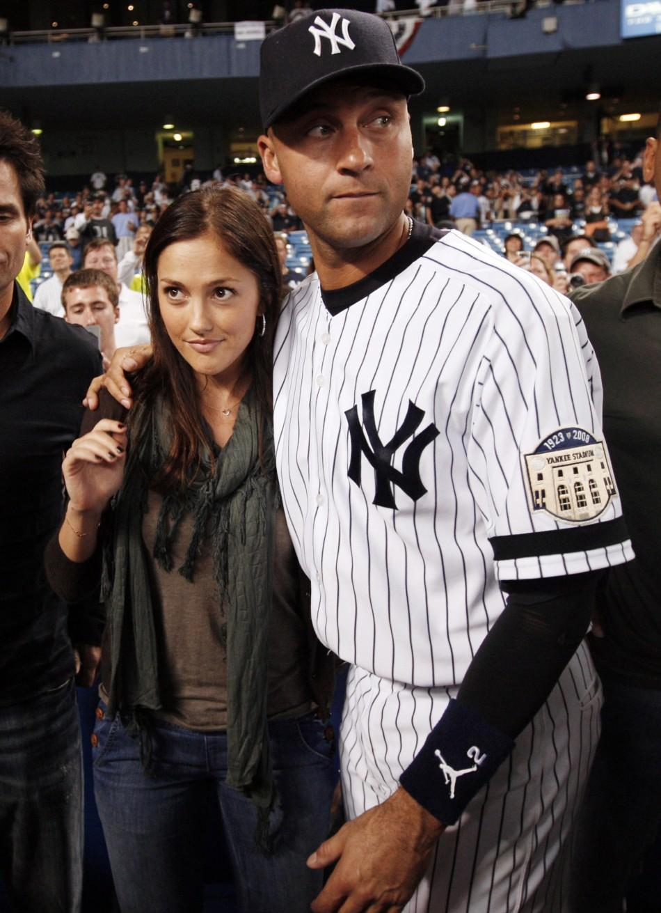 Jeter walks with girlfriend Kelly at Yankee Stadium after final game