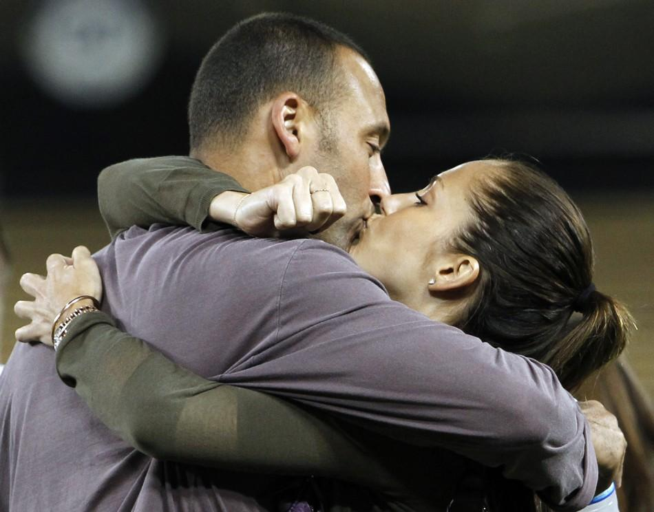 New York Yankees' Derek Jeter and actress Minka Kelly kiss on the field after the Yankees played the Los Angeles Dodgers in an MLB interleague baseball game in Los Angeles