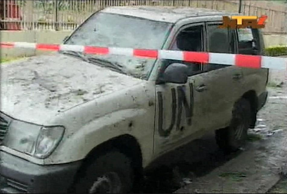 A damaged U.N. vehicle is seen after a bomb blast at the United Nations offices in the Nigerian capital of Abuja