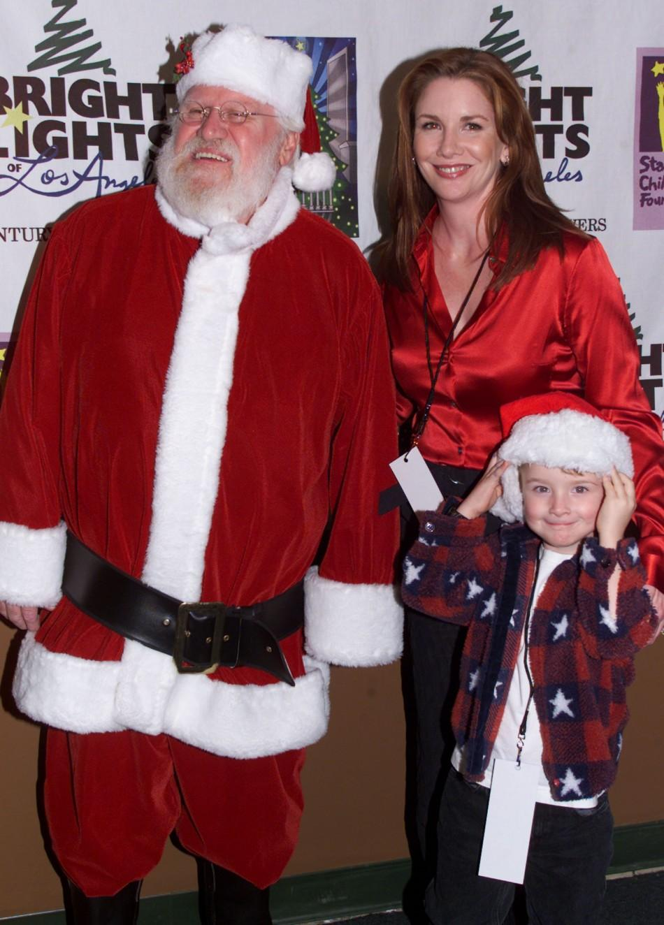 ACTRESS MELISSA GILBERT AND SON POSE WITH SANTA IN LOS ANGELES.