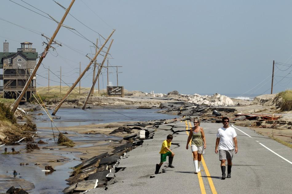 Residents walk along North Carolina's Highway 12 after Hurricane Irene