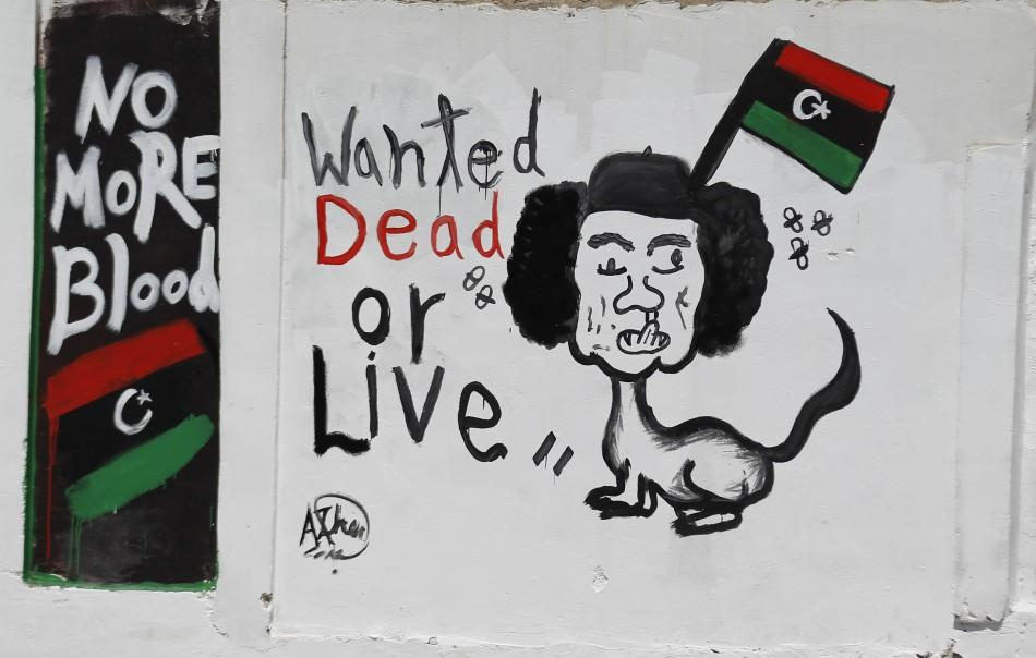 A caricature depicting Muammar Gadhafi is seen in Tripoli