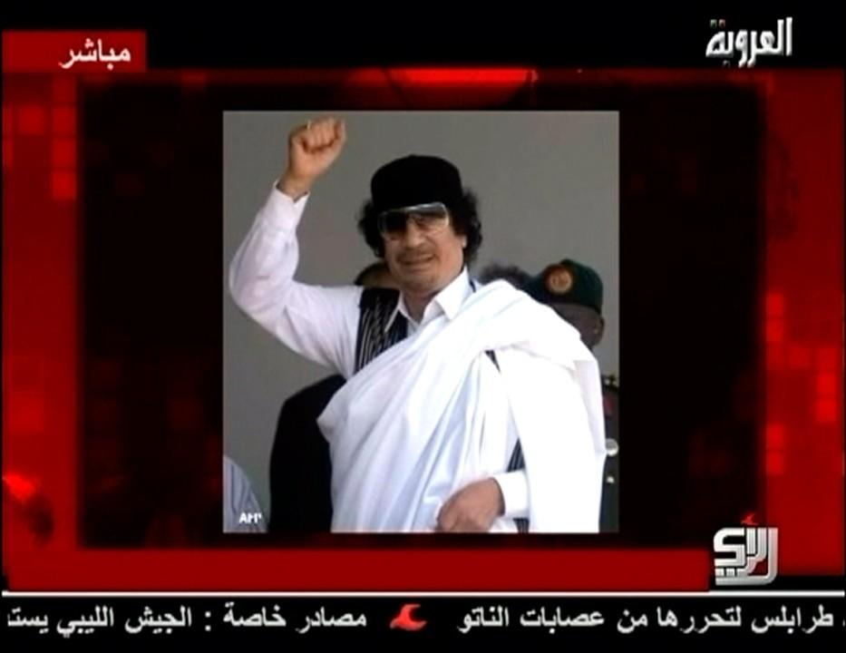A still image of Libyan leader Moammar Gadhafi is displayed to accompany his audio message broadcast by Syrian TV channel Al-Orouba