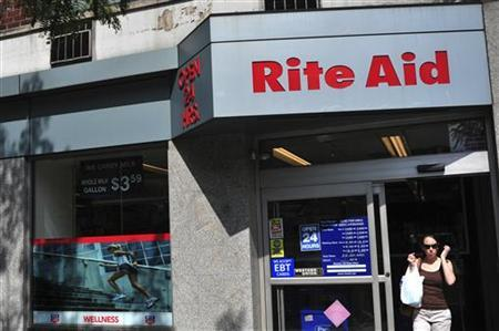 A shopper exits a Rite Aid store in New York
