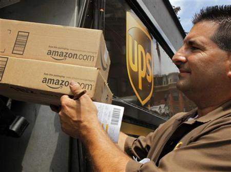 UPS driver T.J. Dellasala delivers two packages from Amazon.com in Boston, Massachusetts