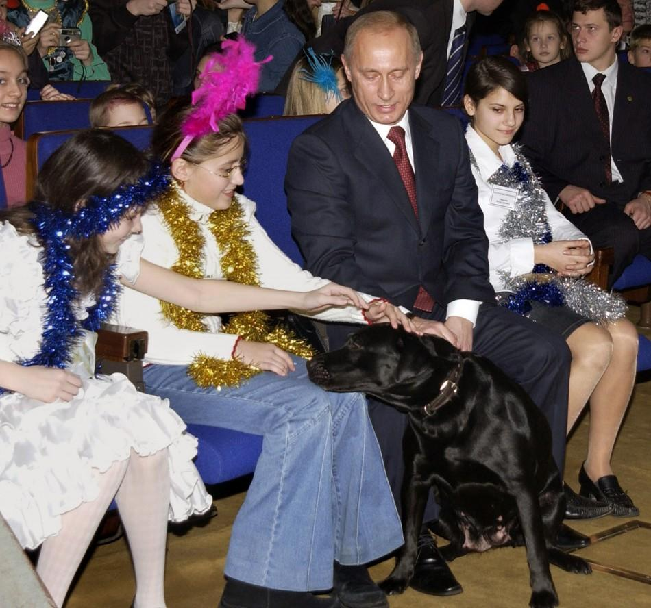 Russian girls pet President Putin's dog Conny during New Year show at State Kremlin Palace in Moscow.