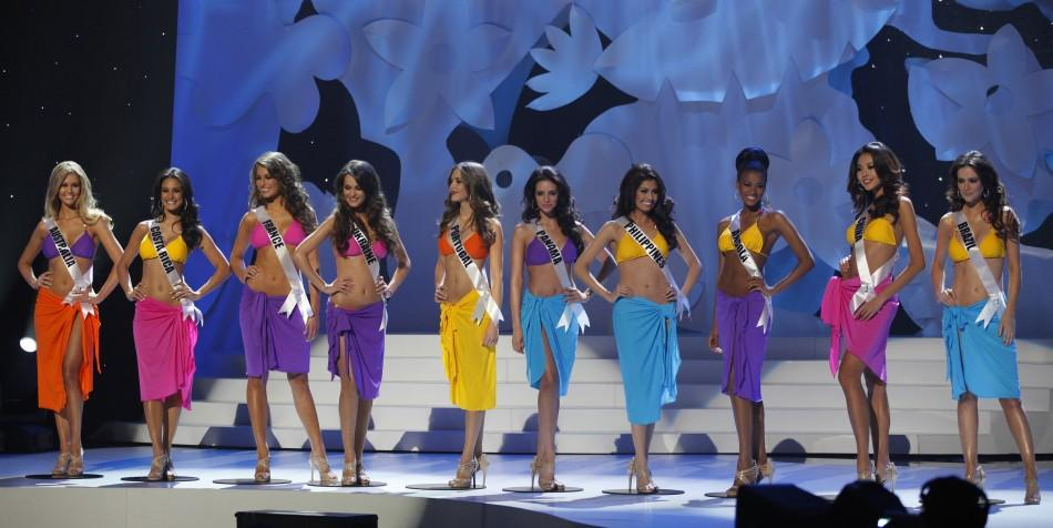 Miss Universe 2011 contestants stand on stage during the pageant in Sao Paulo
