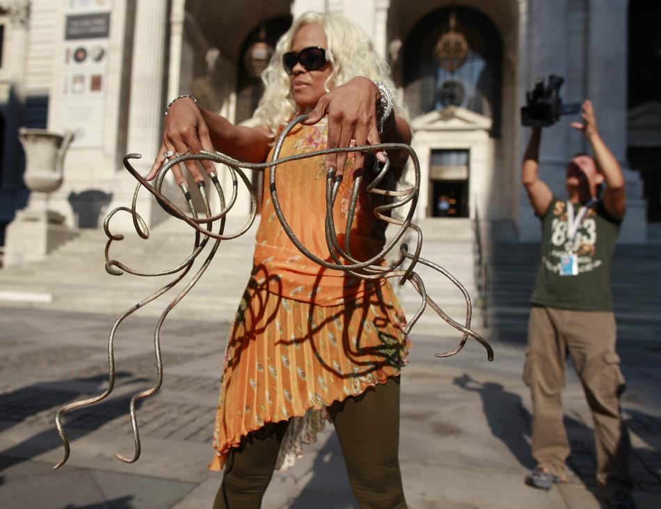 """Chris """"The Duchess"""" Walton shows off her Guinness world record holding fingernails outside the New York Public Library in New York September 14, 2011. Her nails measure 10 feet 2 inches on her left hand and 9 feet 7 inches on her right hand that"""