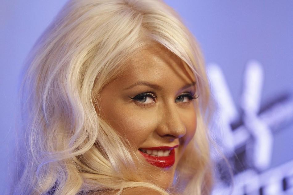 "Aguilera poses during a media event for the upcoming television series ""The Voice"" in Los Angeles."