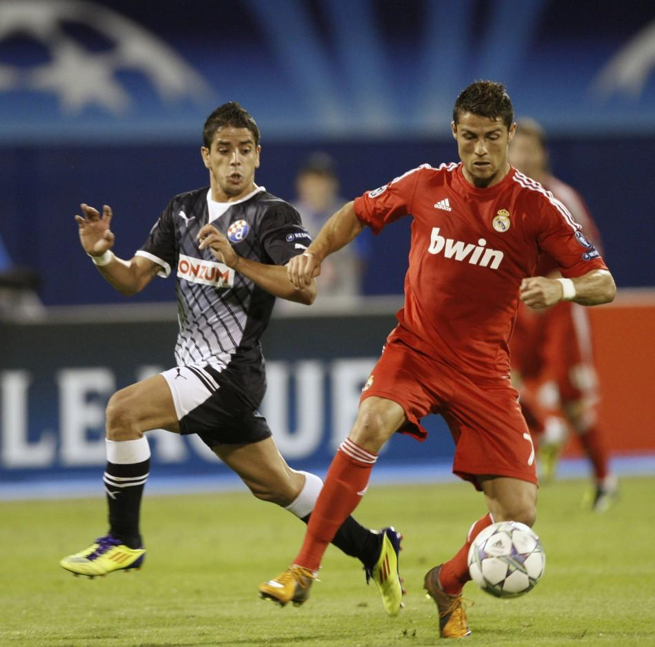 Cristiano Ronaldo (R) of Real Madrid challenges Luis Ibanez of Dinamo Zagreb during their Champions League Group D soccer match at the Maksimir stadium in Zagreb September 14, 2011.