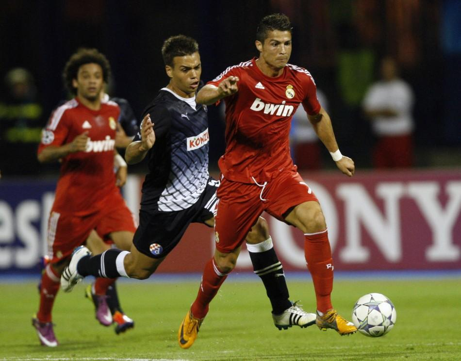 Cristiano Ronaldo (R) of Real Madrid challenges Adrian Calello of Dinamo Zagreb during their Champions League Group D soccer match at the Maksimir stadium in Zagreb September 14, 2011