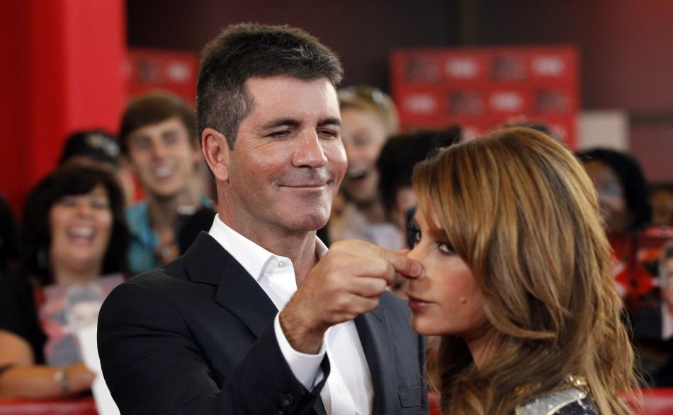 Judge Simon Cowell and Paula Abdul