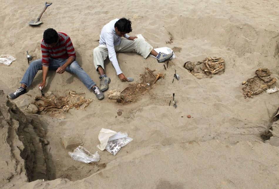 Archaeological students clean some of the unearthed remains of 42 children and 74 camelids, sacrificed approximately 800 years ago and found in the fishing town of Huanchaquito, Trujillo