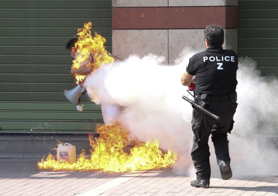 Shocking Photos of Greek Man Setting Himself on Fire