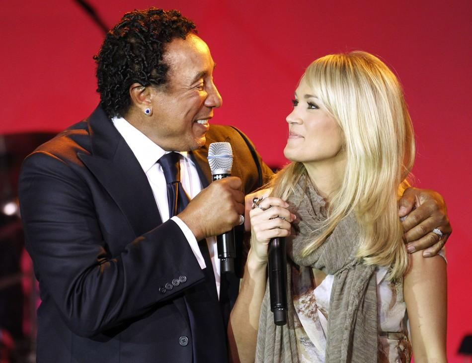 "Singer Smokey Robinson (L), recipient of the 20th Ella Award at the Society of Singers annual dinner, sings ""My Girl"" to Carrie Underwood as Underwood looks on in Beverly Hills, California"