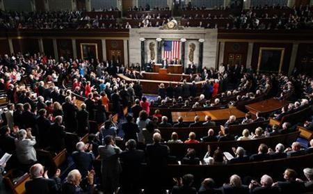U.S. President Barack Obama receives a standing ovation as he addresses a Joint Session of Congress inside the chamber of the House of Representatives on Capitol Hill in Washington