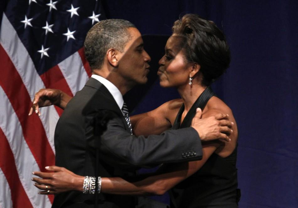 U.S. President Barack Obama kisses first lady Michelle Obama after she introduced him to speak at a fund raiser in New York September 20, 2011