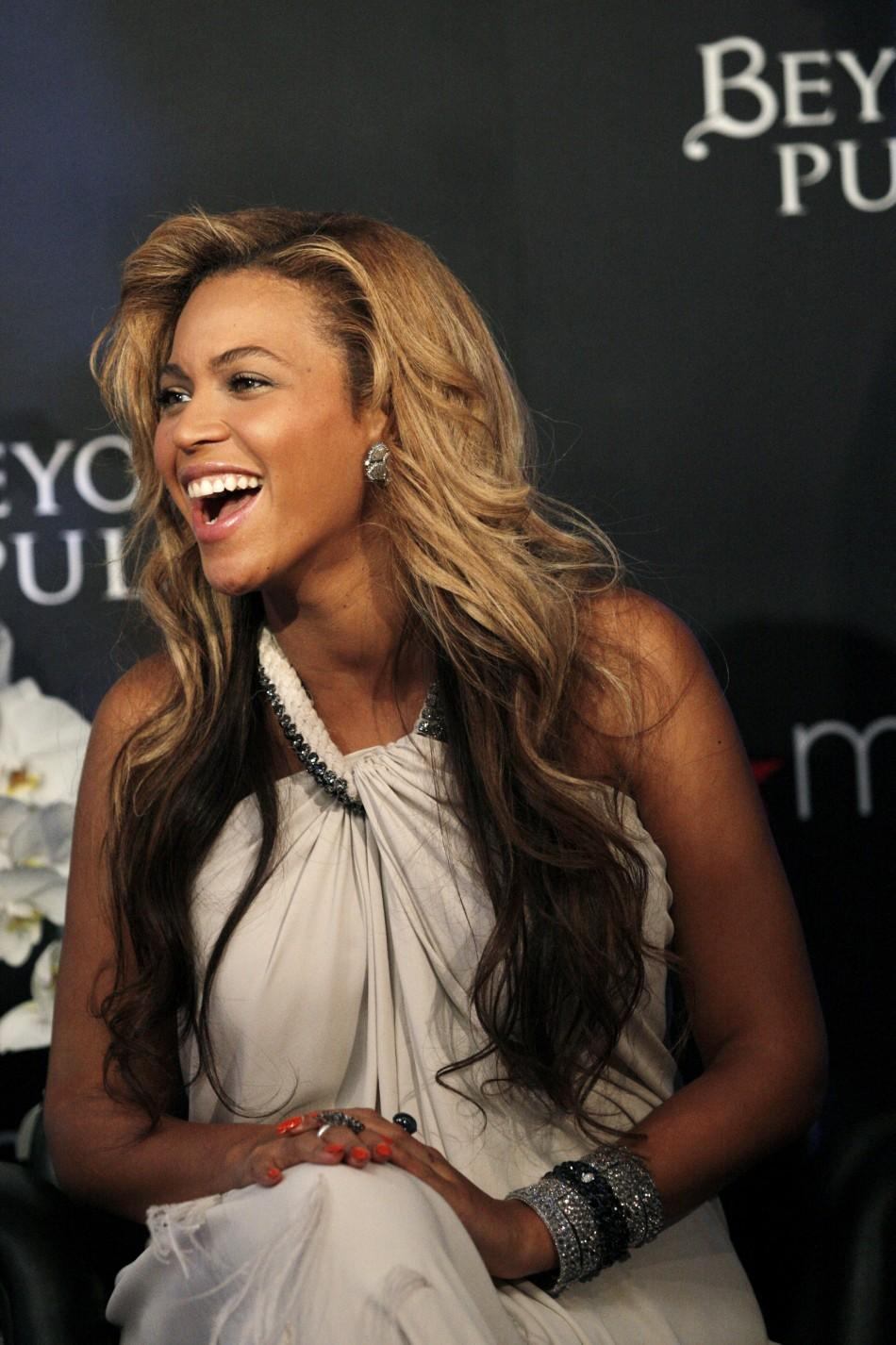 Singer Beyonce smiles during an event to debut her newest fragrance Beyonce Pulse at Macy's store in New York