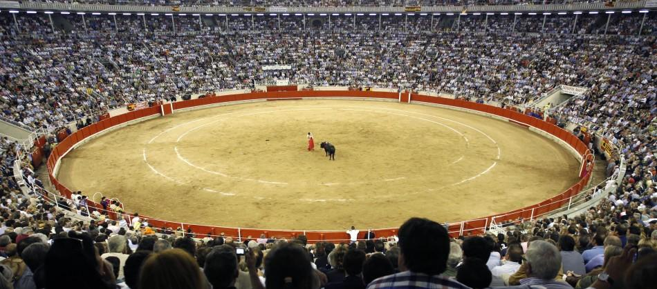 Spanish bullfighter Serafin Martin performs a pass to a bull during the last bullfight