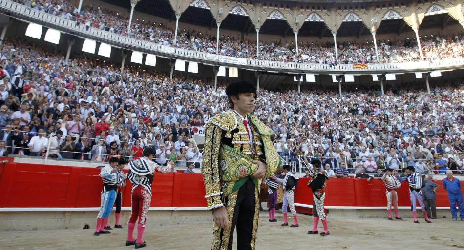 Spanish bullfighter Jose Tomas walks into the arena