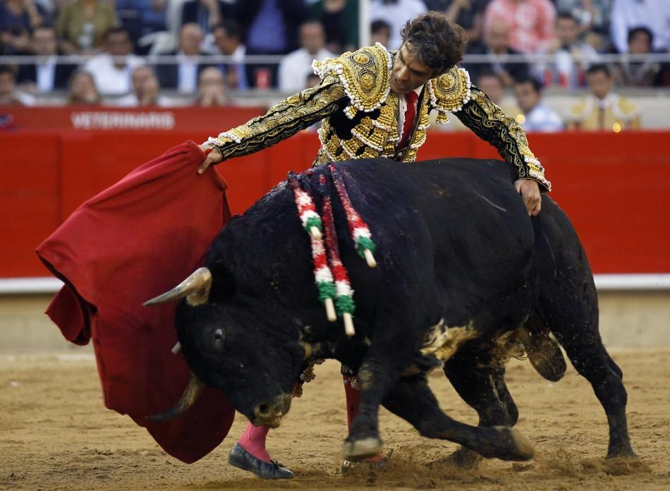 Spanish bullfighter Jose Tomas performs a pass