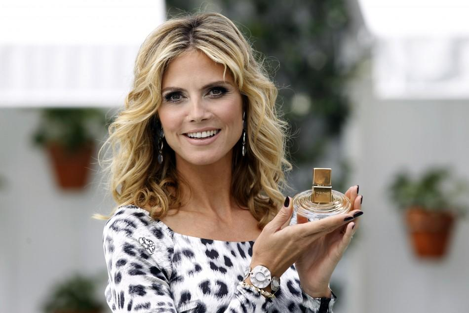 Stunning Heidi Klum Unveils Her New Fragrance Shine in Snow Leopard Print Dress.