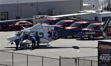 IndyCar driver Dan Wheldon is loaded into a medical helicopter after being injured in a multi-car wreck during the IZOD IndyCar World Championship race at the Las Vegas Motor Speedway in Las Vegas, Nevada