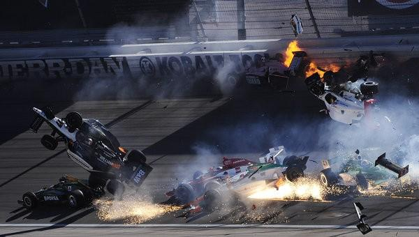The race car of driver Will Power goes airborne during the IZOD IndyCar World Championship race at the Las Vegas Motor Speedway in Las Vegas