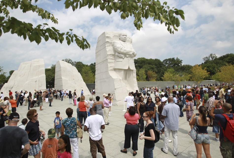Visitors gather around the Martin Luther King, Jr. National Memorial in Washington August 26, 2011