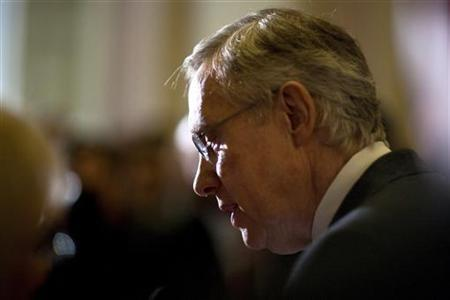 Senate Majority Leader Harry Reid speaks to the media after the U.S. Senate passed a bill allowing a rise in the debt ceiling on Capitol Hill in Washington
