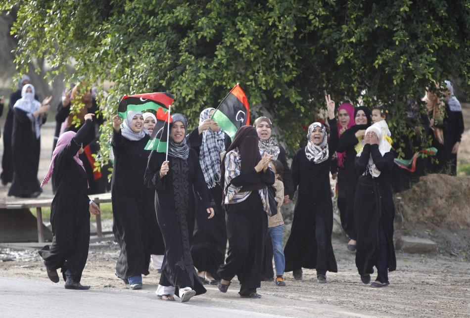 Libyans wave Kingdom of Libya flags in Misrata as they celebrate the fall of Muammar Gaddafi October 20, 2011.