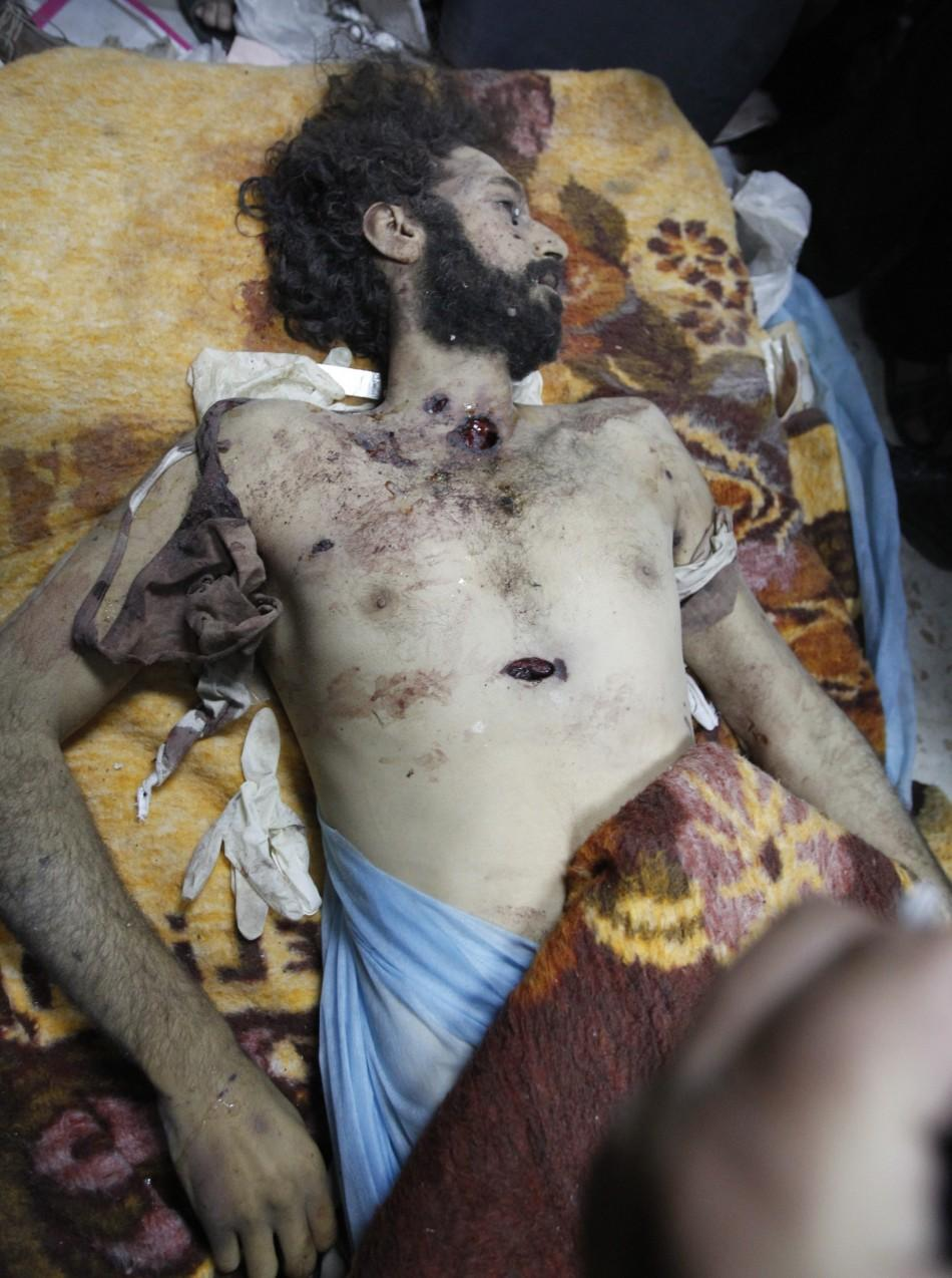 The body of Mo'tassim Gaddafi, son of Muammar Gaddafi, is seen in Misrata after being captured and killed during clashes with anti-Gaddafi fighters in Sirte October 20, 2011.