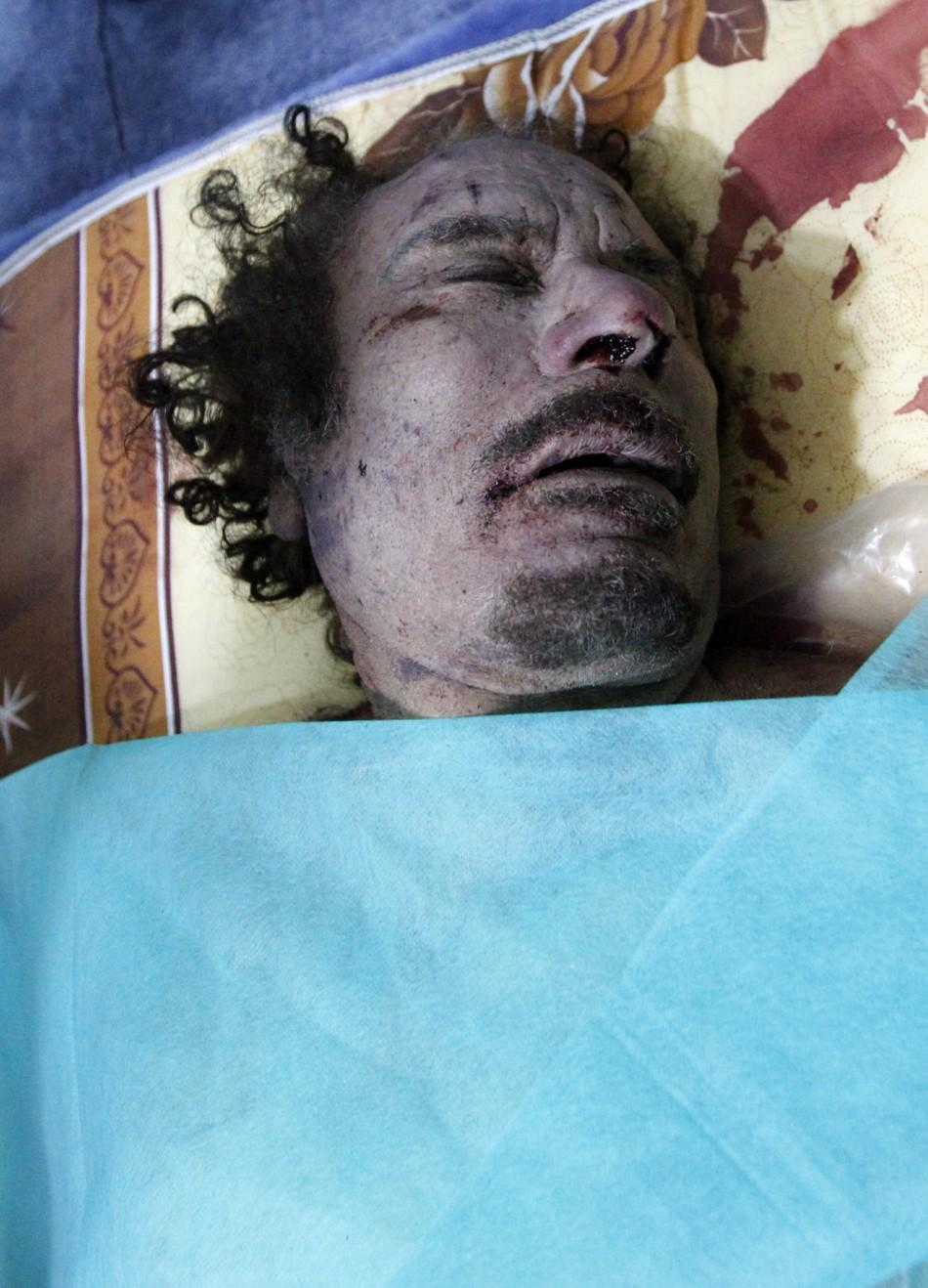 The body of Muammar Gaddafi is seen at a house in Misrata October 20, 2011