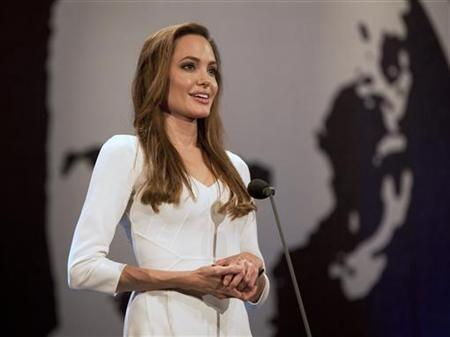 United Nations High Commissioner for Refugees (UNHCR) Goodwill Ambassador Angelina Jolie presents the Nansen prize to Yemen's Society for Humanitarian Solidarity and its founder, Nasser Salim Ali Al-Hamairy (not pictured) at a ceremony in Geneva