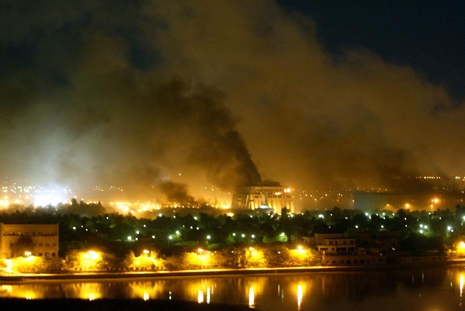 Smoke rises from an unidentified building as explosions rocks Baghdad during air strikes March 21, 2003. U.S.-led forces unleashed a devastating blitz on Baghdad on Friday night, triggering giant fireballs and deafening explosions and sending huge mushroo