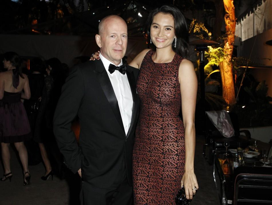 Actor Bruce Willis (L) and his wife Emma Heming pose at The Weinstein Company and Relativity Media's after party for the 68th annual Golden Globe Awards in Beverly Hills, California January 16, 2011.