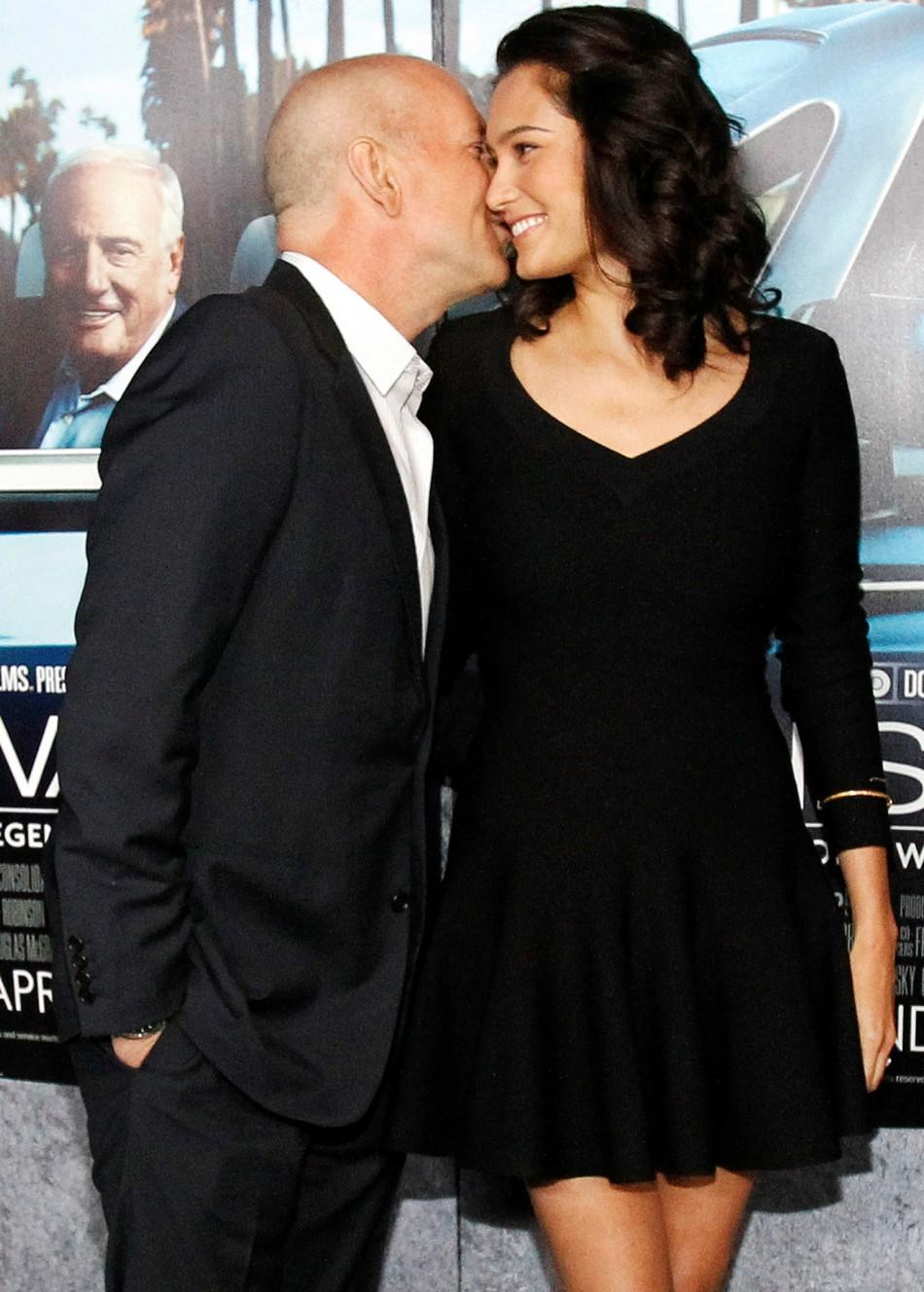 "Actor Bruce Willis and his wife Emma Heming pose at the premiere of the HBO documentary ""His Way"", which portrays the life of legendary movie producer Jerry Weintraub, at the Paramount theatre in Los Angeles March 22, 2011."