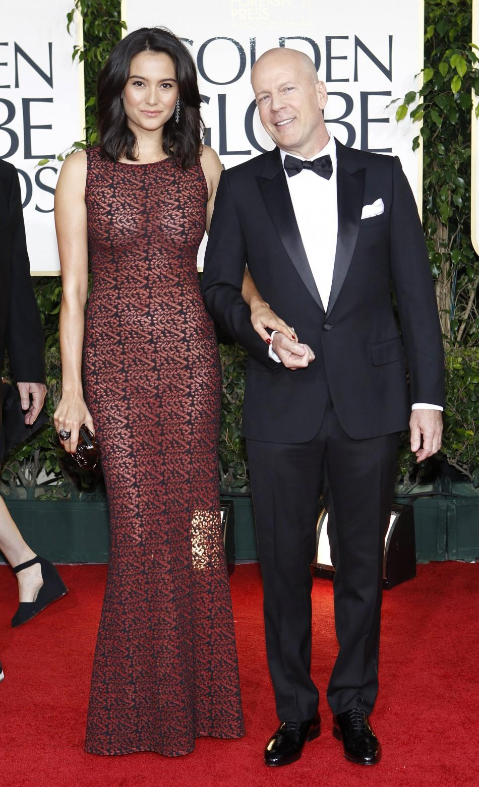 Actor Bruce Willis and his wife Emma Heming arrive at the 68th annual Golden Globe Awards in Beverly Hills, California, January 16, 2011.