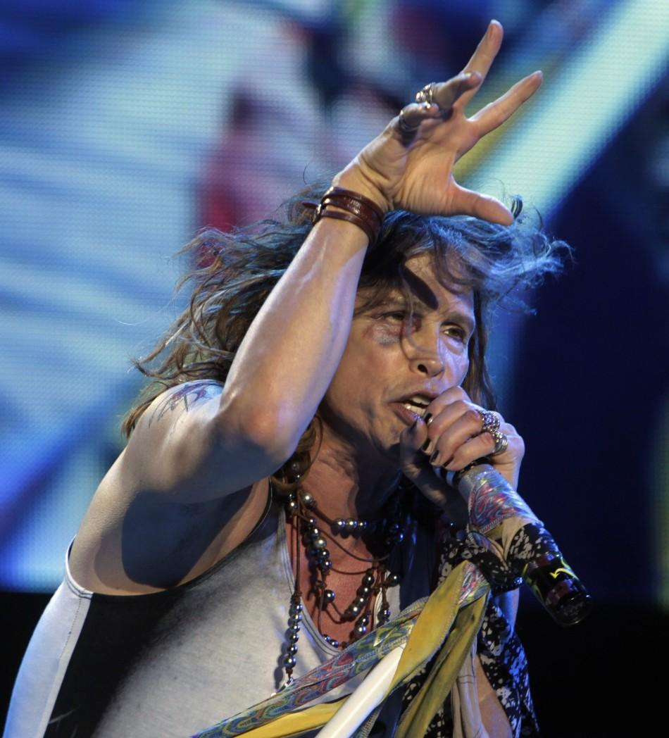 Steven Tyler of Aerosmith performs during a concert on the first stop of their Latin America tour at the Jockey Club in Asuncion October 26, 2011. Tyler, 63, had to be treated in a local hospital on Tuesday for injuries to his face and teeth after an acci