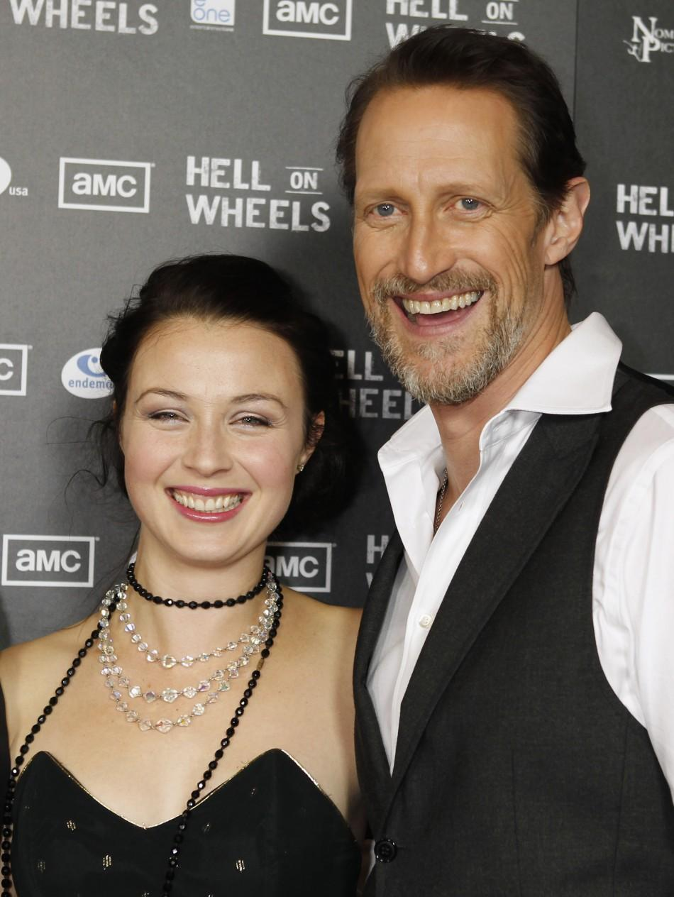 "Cast members Robin McLeavy (L) and Christopher Heyerdahl pose at the premiere screening of AMC cable channel's new series ""Hell on Wheels"" in Los Angeles, California"