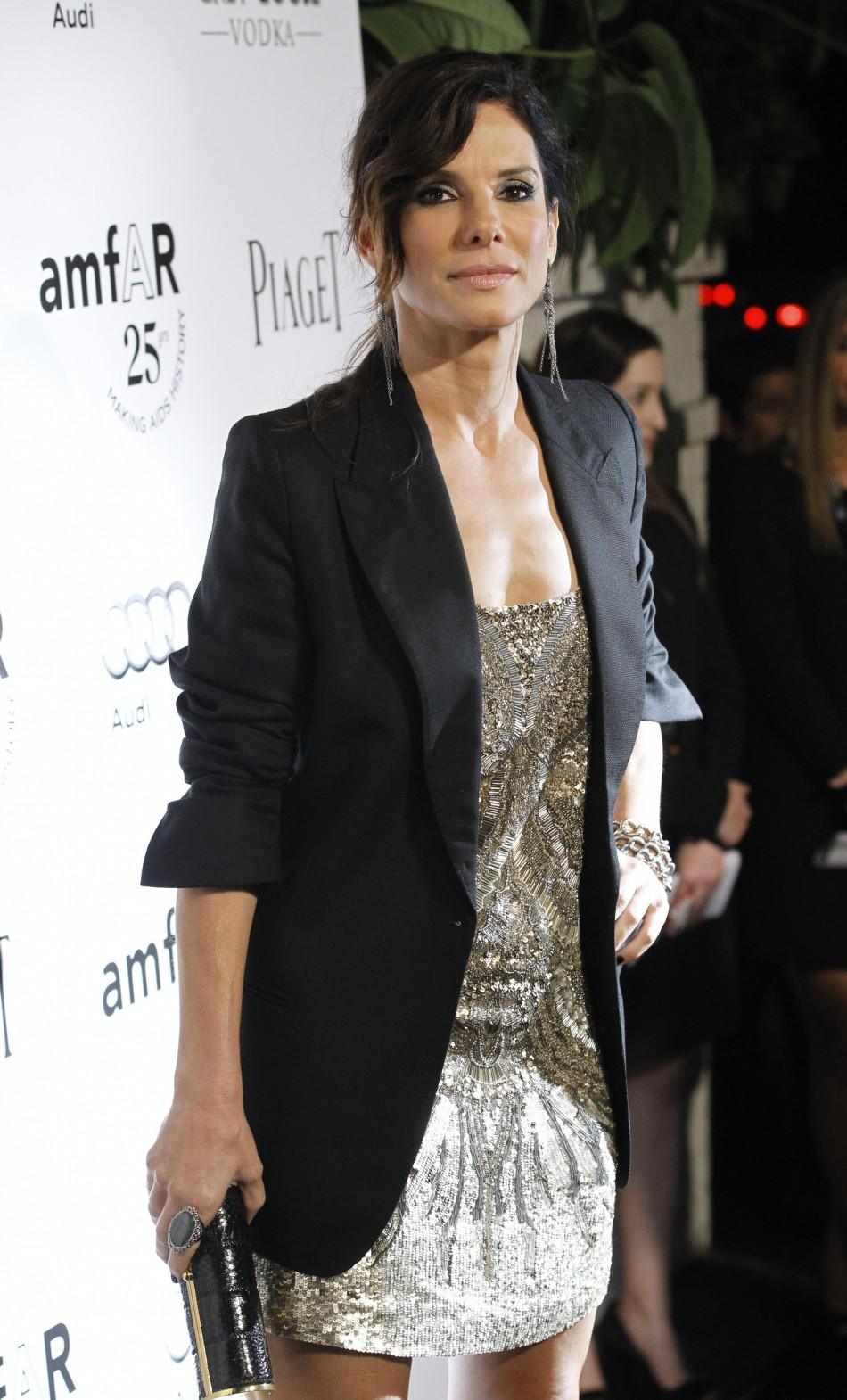 Actress Sandra Bullock poses at the amfAR's Inspiration LA Gala in Hollywood, California