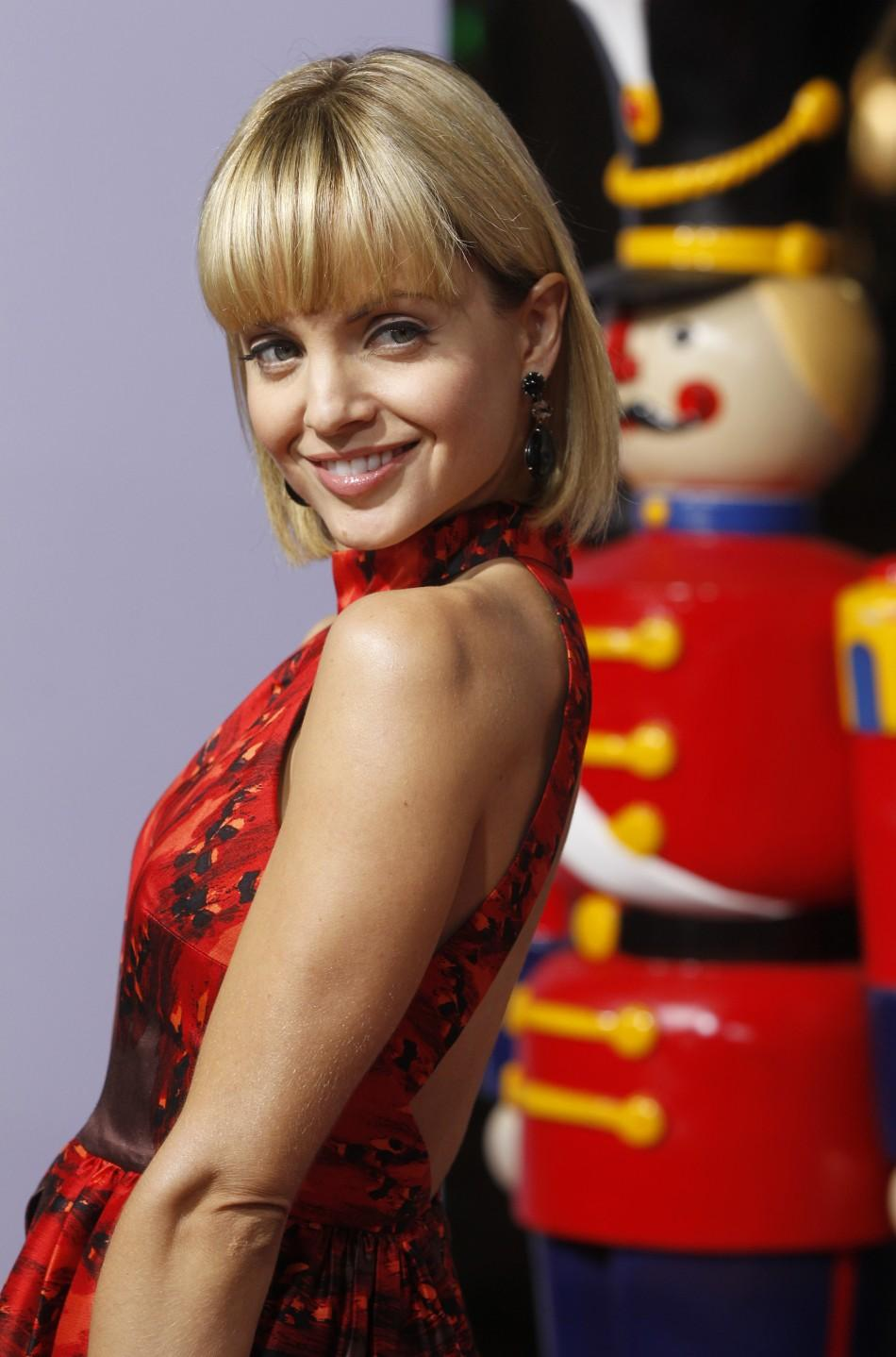 "Actress Mena Suvari poses at the premiere of the new film ""A Very Harold & Kumar 3D Christmas"" in Hollywood"
