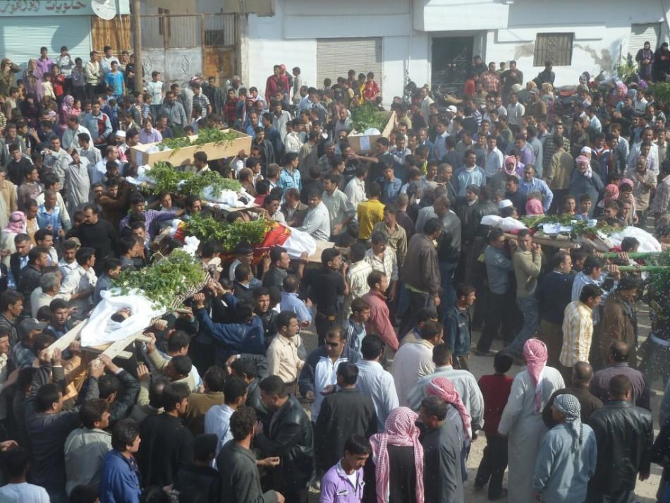 Anti-government protesters carry the coffins of Sunni Muslim villagers killed on Wednesday, in Hula near Homs November 2, 2011